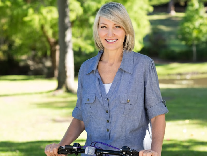 woman over 50 on bicycle