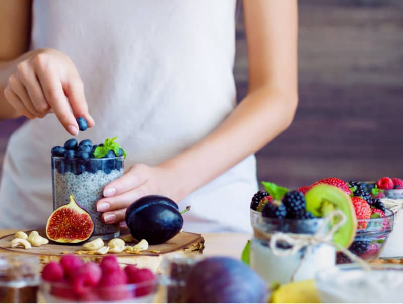 Women eating healthy food to heal adrenal fatigue