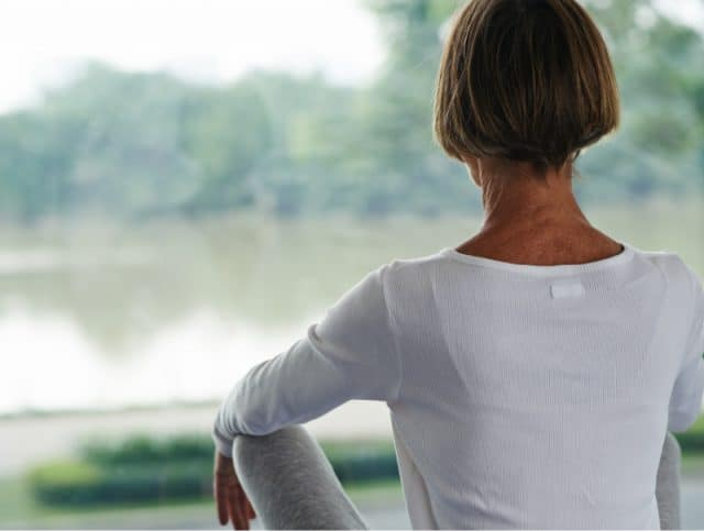 woman in menopause meditating to fix adrenal fatigue