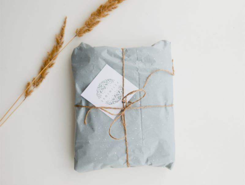 A gift with gift tag and string bow