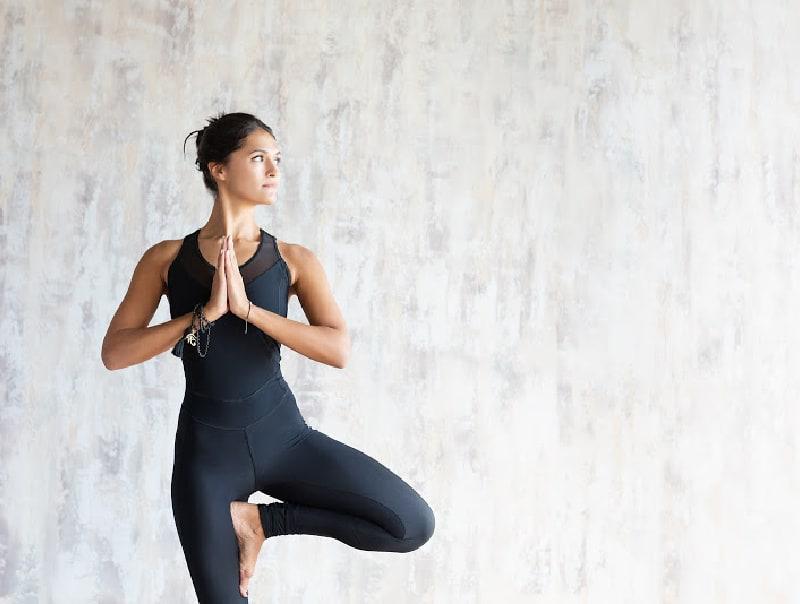 woman doing tree pose in yoga