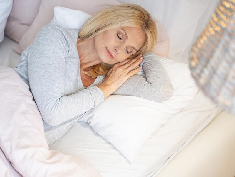 older woman getting a good nights sleep