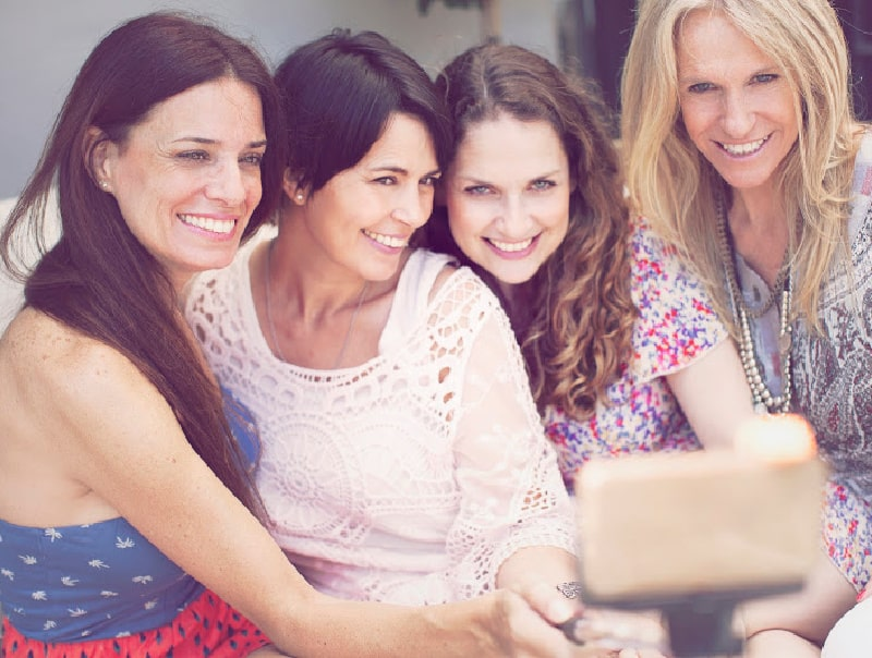 group of older women taking a selfie