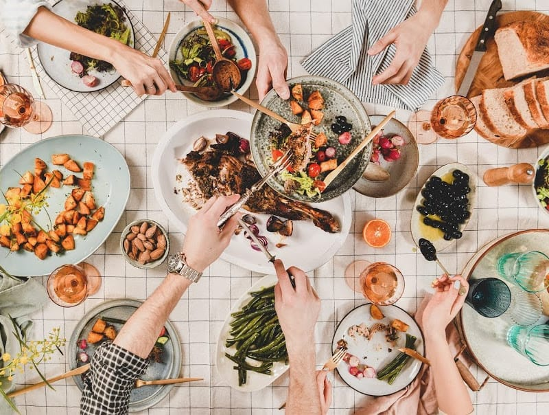 flat lay of peoples selecting healthy food of plates