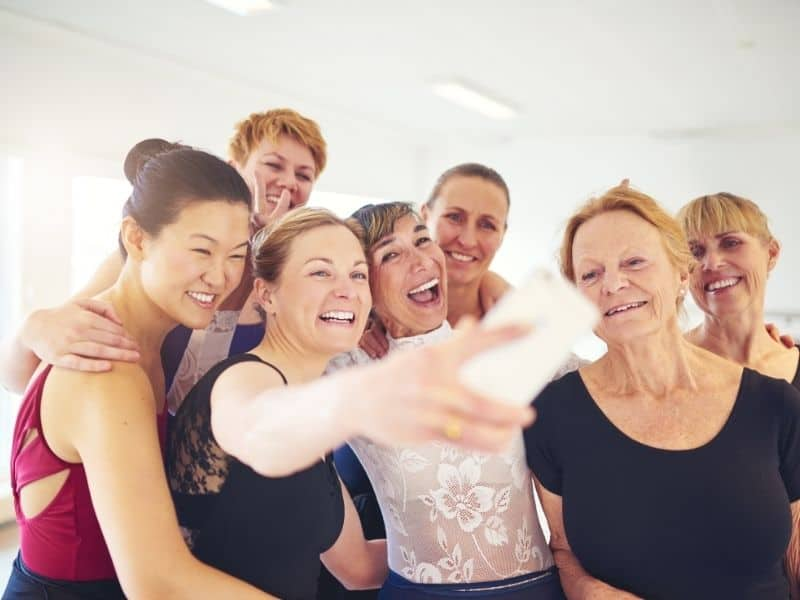 older women taking selfie after doing their exercise to lose menopause belly fat