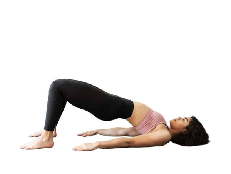 woman doing bridge pose in yoga to tighten belly muscles