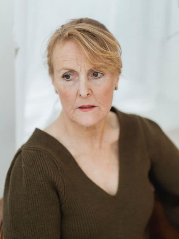 woman with estrogen dominance in menopause looking confused and foggy