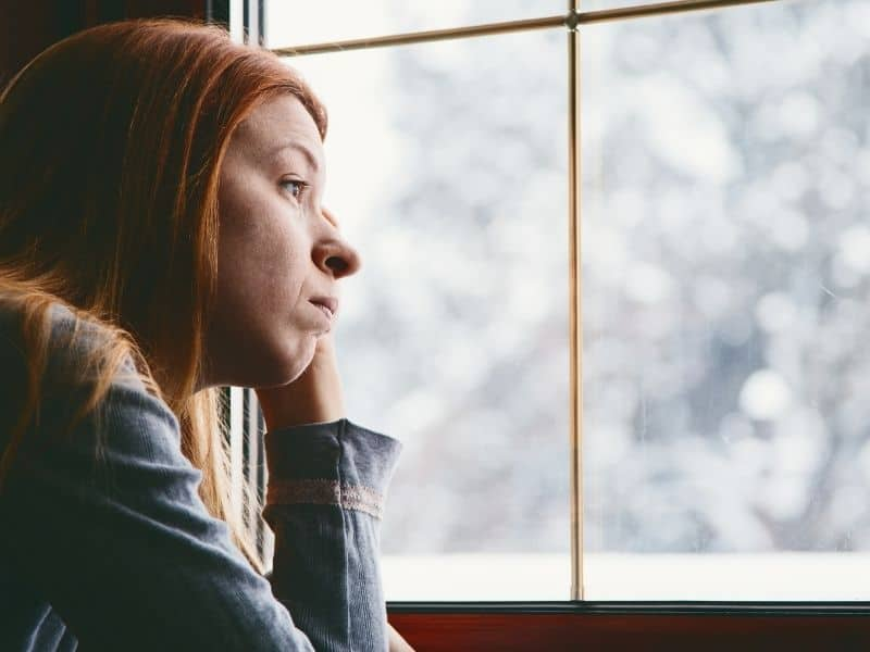 woman with estrogen dominance looking moody and sad