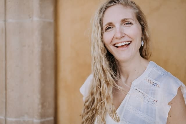 Woman with hormonal imbalance in midlife smiling into the camera